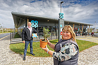 L-R Contractor Lee Berry who kept safe a moneyplant from the old store, for store manager Louise Hughes.