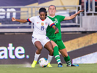 PASADENA, CA - AUGUST 4: Crystal Dunn #19 and Harriet Scott #3 fight for the ball during a game between Ireland and USWNT at Rose Bowl on August 3, 2019 in Pasadena, California.