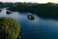 Aerial view of the Rock Islands in the late afternoon Natural Arch Area,Palau, <br /> Micronesia