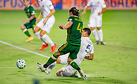 CARSON, CA - OCTOBER 07: Jorge Villafana #4 of the Portland Timbers battles with Daniel Steres #5 of the Los Angeles Galaxy during a game between Portland Timbers and Los Angeles Galaxy at Dignity Heath Sports Park on October 07, 2020 in Carson, California.