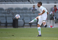 LOS ANGELES, CA - APRIL 17: Diego Fagundez #14 of Austin FC passes off the ball during a game between Austin FC and Los Angeles FC at Banc of California Stadium on April 17, 2021 in Los Angeles, California.