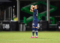 LAKE BUENA VISTA, FL - JULY 26: Luis Martins of Sporting KC takes a drink during a game between Vancouver Whitecaps and Sporting Kansas City at ESPN Wide World of Sports on July 26, 2020 in Lake Buena Vista, Florida.
