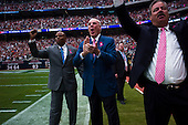 Houston, Texas<br /> October 2, 2011<br /> <br /> Team owner Bob McNair (blue jacket) with son Cary McNair (black jacket) and general manager and first as executive vice president, Rick Smith (grey jacket) on the sidelines cheer as the Houston Texans score the game's first touchdown.<br /> <br /> The Houston Texans defeated the Pittsburgh Steelers at the Reliant Stadium 17 to 10.