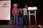 Casen Gines and Bronc DeMers during the bareback and saddle bronc back  number  presentation at the Junior World Finals Rodeo. Photo by Andy Watson. Written permission must be  provided  to use  this  photo  in any manner.