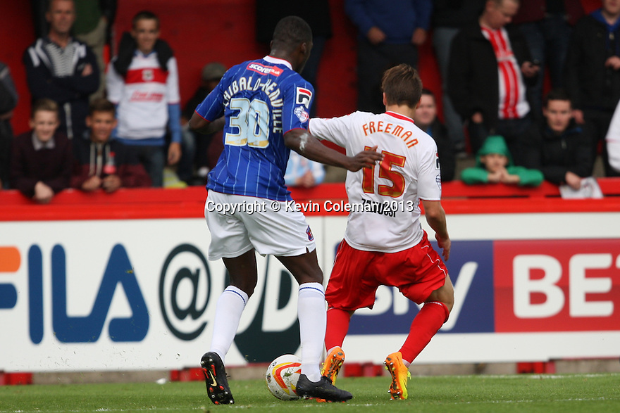Luke Freeman of Stevenage is tripped by Troy Archibald-Henville of Carlisle and wins a penalty<br />  - Stevenage v Carlisle Untied - Sky Bet League 1 - Lamex Stadium, Stevenage - 21st September, 2013<br />  © Kevin Coleman 2013