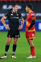 Gavin Henson of the Dragons (R) speaks with James Hook (L) of the Ospreys (R) during the Guinness PRO14 match between Ospreys and Dragons at The Liberty Stadium, Swansea, Wales, UK. Friday 27 October 2017