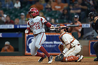 Christian Franklin (25) of the Arkansas Razorbacks follows through on his swing against the Texas Longhorns in game six of the 2020 Shriners Hospitals for Children College Classic at Minute Maid Park on February 28, 2020 in Houston, Texas. The Longhorns defeated the Razorbacks 8-7. (Brian Westerholt/Four Seam Images)