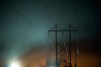High voltage power lines on foggy winter night