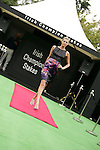 Horse Racing - Leopardstown Racecourse - Irish Champion Stakes.A model struts on the catwalk during the Tattersalls Millions Irish Champion Stakes day at Leopardstown Racecourse in Dublin.