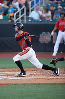 Hudson Haskin (26) of the Aberdeen IronBirds follows through on his swing against the Hudson Valley Renegades at Leidos Field at Ripken Stadium on July 23, 2021, in Aberdeen, MD. (Brian Westerholt/Four Seam Images)