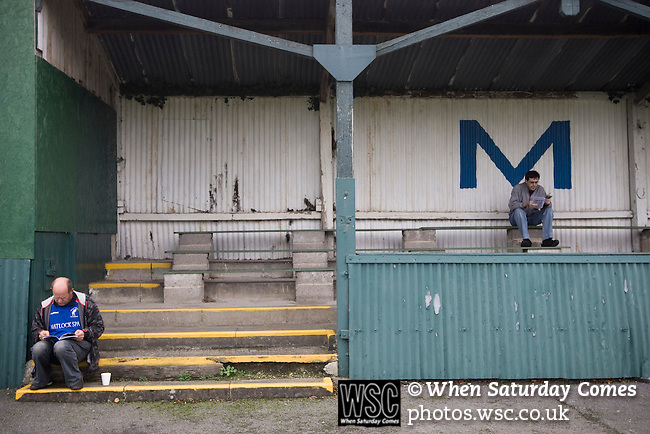 Matlock Town 0 Eastwood Town 3, 09/10/2010. Causeway Lane, FA Cup 3rd qualifying round. Two Matlock Town fans reading the matchday programme before the FA Cup 3rd qualifying round tie between Matlock Town and Eastwood Town at Causeway Lane, Matlock. The visitors from Nottingham who play one division higher than Matlock won by three goals to nil to move to within one round of the FA Cup 1st round proper. The match was watched by 655 spectators. Photo by Colin McPherson.
