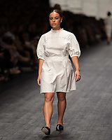 A model wearing a design by MATIN walks at the Runway 3 show of the 2020 Virgin Australian Melbourne Fashion at the Royal Exhibition Building in Melbourne, Australia. Photo Sydney Low