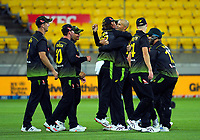 Australian bowler Ashton Agar congratulates Adam Zampa for catching Mark Chapman during the third international men's T20 cricket match between the New Zealand Black Capss and Australia at Sky Stadium in Wellington, New Zealand on Wednesday, 3 March 2021. Photo: Dave Lintott / lintottphoto.co.nz