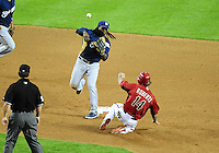 Apr. 3, 2012; Phoenix, AZ, USA; Milwaukee Brewers second baseman Rickie Weeks throws to first base to complete the double play after forcing out Arizona Diamondbacks base runner Ryan Roberts (14) in the fifth inning during a spring training game at Chase Field.  Mandatory Credit: Mark J. Rebilas-