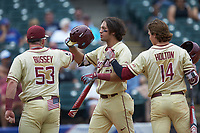 Drew Mendoza (22) of the Florida State Seminoles celebrates with teammates Tyler Holton (14) and Bryan Bussey (53) after scoring a run during the game against the North Carolina Tar Heels in the 2017 ACC Baseball Championship Game at Louisville Slugger Field on May 28, 2017 in Louisville, Kentucky. The Seminoles defeated the Tar Heels 7-3. (Brian Westerholt/Four Seam Images)