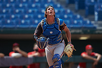 Catcher Cole Russo (33) of Tampa Jesuit HS in Tampa, FL playing for the San Francisco Giants scout team tracks a pop fly during the East Coast Pro Showcase at the Hoover Met Complex on August 5, 2020 in Hoover, AL. (Brian Westerholt/Four Seam Images)