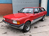 BNPS.co.uk (01202 558833)<br /> Pic: HampsonAuctions/BNPS<br /> <br /> Pictured: 1983 Ford Cortina 1.6 Crusader Estate.<br /> <br /> Since the 1990s, Geoff Barlow, 46, has collected dozens of classic cars from an Escort Mexico replica to several types of Transit, Cortina, and Sierra.<br /> <br /> However, he still regrets selling the first car which inspired his passion, a 1980 Escort Mark 2 he bought from his sister in 1992.  <br /> <br /> Geoff's fascination with Fords gathered pace in the last decade and he 'lost control,' buying as many Fords as he came across and saving them from disrepair.