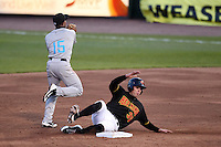 Rochester Red Wings first baseman Aaron Bates #35 slides into second as Josh Johnson #15 turns a double play during a game against the Syracuse Cheifs at Frontier Field on April 25, 2012 in Rochester, New York.  Syracuse defeated Rochester 10-5.  (Mike Janes/Four Seam Images)