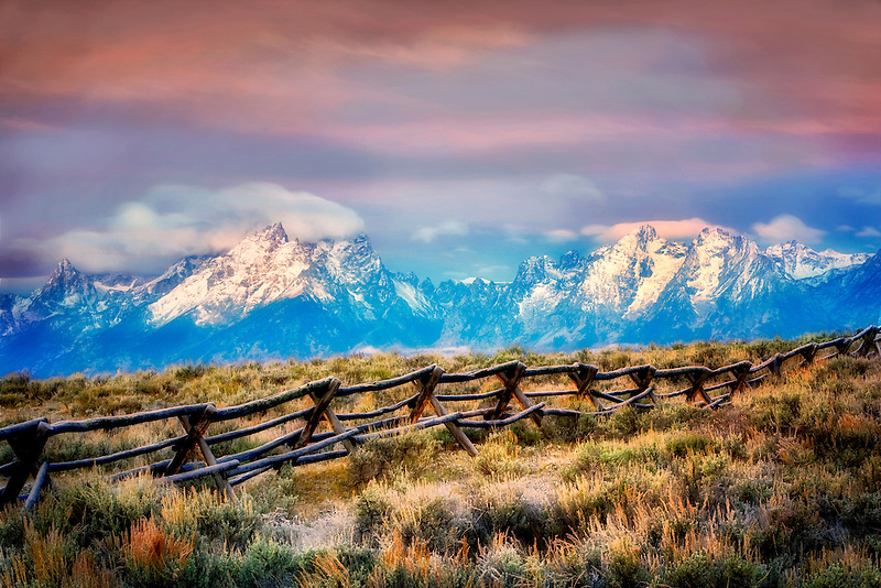 First light on fence and Grand Teton Mountains. Grand Teton National Park, WY