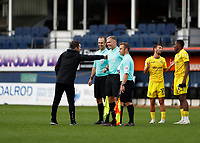 3rd October 2020; Kenilworth Road, Luton, Bedfordshire, England; English Football League Championship Football, Luton Town versus Wycombe Wanderers; Luton Town Manager Nathan Jones gives a pat on the shoulder to Referee Graham Scott alongside Assistant Referee Henry Lennard with a disappointed Scott Kashket of Wycombe Wanderers talking to Dennis Adeniran of Wycombe Wanderers