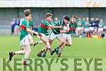Oisin Maunsell of St Brendans breaks forward despite the attention from Mid Kerrys Diarmuid McGillicuddy and Keith Evans in the Minor Football Championship quarter final.