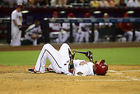 Jun. 8, 2012; Phoenix, AZ, USA; Arizona Diamondbacks batter Ryan Roberts reacts after fouling a ball off his foot in the fourth inning against the Oakland Athletics at Chase Field.  Mandatory Credit: Mark J. Rebilas-