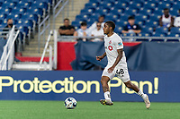 FOXBOROUGH, MA - JULY 23: Dante Campbell #48 of Toronto FC II brings the ball forward during a game between Toronto FC II and New England Revolution II at Gillette Stadium on July 23, 2021 in Foxborough, Massachusetts.
