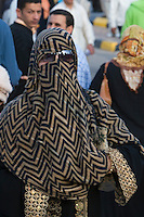 Tripoli, Libya, North Africa - Veiled Woman at International Trade Fair.  Clothing Styles.