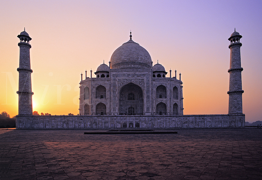 Classic frontal view of the Taj Mahal flanked by its tall minarets at sunset; Agra, Indi
