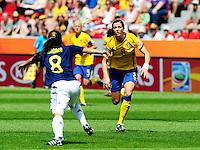 Fifa Women's World Cup Germany 2011 : Colombia - Sweden at Bayarena Leverkusen : Lotta Schelin gefocust op de bal voor Andrea Peralta ..foto DAVID CATRY / Vrouwenteam.be