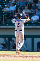 Salt River Rafters third baseman Josh Fuentes (19), of the Colorado Rockies organization, points to the sky as he crosses home plate after hitting a home run during an Arizona Fall League game against the Mesa Solar Sox at Sloan Park on October 30, 2018 in Mesa, Arizona. Salt River defeated Mesa 14-4 . (Zachary Lucy/Four Seam Images)
