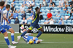 Oluwatomisin Adeloye of Ayr goes down after a challenge from Jason Naismith of Kilmarnock. Referee Don Robertson decided no foul was commited.  Kilmarnock 2 Ayr United 0, Scottish Championship, August 2nd 2021. Following Kilmarnock's relegation in 2020-21, the first game of the new season is the Ayreshire Derby, the first league match between the teams in 28 years. Due to relaxation of Covid restrictions the match was played in front of a crowd of 3200 Kilmarnock fans. The game was shown live on BBC Scotland.