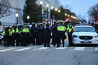 Washington, DC - January 6, 2021: Police officers stand ready near the U.S. Capitol as thousands of protesters in support of President Donald Trump surround building January 6, 2021 as Congress was in session to accept the electors of the November 3 presidential election.  (Photo by Don Baxter/Media Images International)