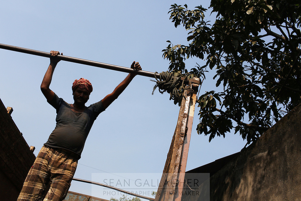 A worker stands on a lorry in central Kolkata, India. November, 2013