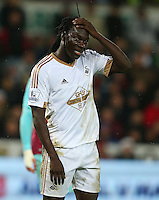 Bafetibis Gomis of Swansea City shows a look of dejection during the Barclays Premier League match between Swansea City and West Ham United played at The Liberty Stadium, Swansea on 20th December 2015