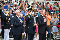 (From the left): U.S. Vice President Mike Pence; Maj. Gen. Michael Howard, commanding general, U.S. Army Military District of Washington; and Acting Secretary of Defense Patrick Shanahan; render honors during an Armed Forces Full Honors Wreath-Laying Ceremony in observance of Memorial Day at Arlington National Cemetery, Arlington, Virginia, May 27, 2019. This was the 151st annual Memorial Day Observation at Arlington National Cemetery. (U.S. Army photo by Elizabeth Fraser / Arlington National Cemetery / released)