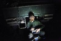 Afghanistan, 25.10.2011, Nawabad. Ein Soldat sitzt nachts vor einem Dingo und lacht kraeftig. Die in Kundus stationierte 3. Task Force (ISAF) der Bundeswehr beginnt im Oktober 2011 die mehrtaegige Operation Orpheus. Durch Patrouillen in und um die Kleinstadt Nawabad (Dirstrikt Chahar Dareh) westlich von Kundus, Nordafghanistan, versuchen die rund 100 Infanteristen Rueckzugsorte Aufstaendischer unmoeglich zu machen. Unterstuetzt werden sie dabei durch einen Zug afghanischer Soldaten. A private laughs at night sitting in front of a armored Dingo. In October 2011 Kunduz based 3.Task Force started a several days operation in and around Nawabad (District Chahar Dareh), west of Kunduz, northern Afghanistan. During the Operation Orpheus about 100 german infantry soldiers went out for patrols through the town and surrounding areas, which were expected as a retreat zone of insurgents. A platoon of afghan soldiers supports the german forces. © Timo Vogt/Est&Ost, NO MODEL RELEASE !!
