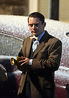 Pictured: Elijah Wood warms up his hands with a hot water bottle. Tuesday 11 February 2014<br />