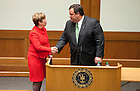 """November 18, 2011; Dean Nell Jessup Newton shakes hands with New Jersey Gov. Chris Christie at the end of his keynote address during a daylong symposium, titled """"Educational Innovation and the Law"""" in the Patrick F. McCartan Courtroom at the Notre Dame Law School. Photo by Barbara Johnston/University of Notre Dame."""