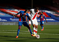 12th September 2020; Selhurst Park, London, England; English Premier League Football, Crystal Palace versus Southampton; Danny Ings of Southampton being marked by Cheikhou Kouyate of Crystal Palace