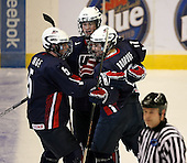 January 30, 2009:  Forward Ryan Bourque (17) of Team USA 18 and under development team celebrates a goal with Nick Mattson (27) and John Ramage (5) during a game vs. the Rochester Institute of Technology (RIT) at Blue Cross Arena in Rochester, NY.  Team USA defeated R.I.T. 6-3.  Photo copyright Mike Janes Photography 2009Bourque has verbally committed to the University of New Hampshire (HEA); son of former NHL star Ray Bourque.