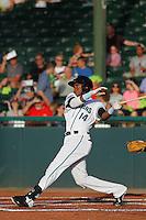 Daytona Tortugas outfielder Junior Arias (14) hitting a home run during a game against the Tampa Yankees at Radiology Associates Field at Jackie Robinson Ballpark on June 13, 2015 in Daytona, Florida. Tampa defeated Daytona 8-6. (Robert Gurganus/Four Seam Images)