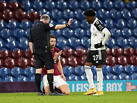 17th February 2021; Turf Moor, Burnley, Lanchashire, England; English Premier League Football, Burnley versus Fulham; James Tarkowski of Burnley speaks with referee Jonathan Moss after suffering an accidental blow to his face