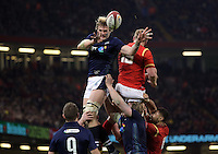 Richie Gray of Scotland (L) passes the ball from a line out during the RBS 6 Nations Championship rugby game between Wales and Scotland at the Principality Stadium, Cardiff, Wales, UK Saturday 13 February 2016