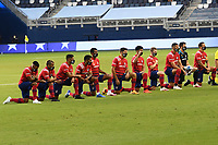 KANSAS CITY, KS - SEPTEMBER 02: FC Dallas players take a knee prior to kick off during a game between FC Dallas and Sporting Kansas City at Children's Mercy Park on September 02, 2020 in Kansas City, Kansas.