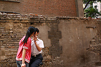 CHINA. Beijing. A young couple in the Xidan shopping district in central Beijing. 2006.