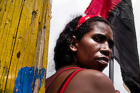 A Nicaraguan woman holds the black-and-red Sandinistas flag during the pre-election meeting in San Juan del Sur, Nicaragua, 16 October 2004. The Sandinista National Liberation Front (in Spanish: Frente Sandinista de Liberación Nacional, or FSLN) is a socialist political party in Nicaragua. The FSLN is one of Nicaragua's two leading parties. Sandinistas took their name from Augusto César Sandino (1895-1934), the historical leader of Nicaragua's nationalist rebellion against the US occupation of the country in the 1930s. In 1979 the FSLN overthrew the Somoza dynasty and ruled Nicaragua from 1979 to 1990. They left power in 1990 after free elections. In 2006, the former President Daniel Ortega, the leader of the party, was re-elected President of Nicaragua.