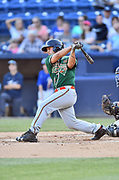 Greensboro Grasshoppers catcher Michael Hernandez (17) swings at a pitch during a game against the Asheville Tourists at McCormick Field on May 10, 2018 in Asheville, North Carolina. The Tourists defeated the Grasshoppers 14-10. (Tony Farlow/Four Seam Images)