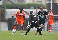Pictured L-R: Nathan Dyer of Swansea against Jack Lewis and Lee Trundle of Neath. Saturday 17 July 2011<br /> Re: Pre season friendly, Neath Football Club v Swansea City FC at the Gnoll ground, Neath, south Wales.