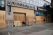 New York New York<br /> June 5, 2020<br /> <br /> <br /> After several nights of looting, nearly all ground level windows in Manhattan are covered with plywood. Broadway, 5th Avenue, Times Square, Columbus Circle are all covered in wood. Many of the shops had already been looted.